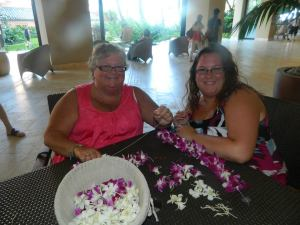 Making Lei's in Hawaii to take home to Gma and Gpa's Graves.